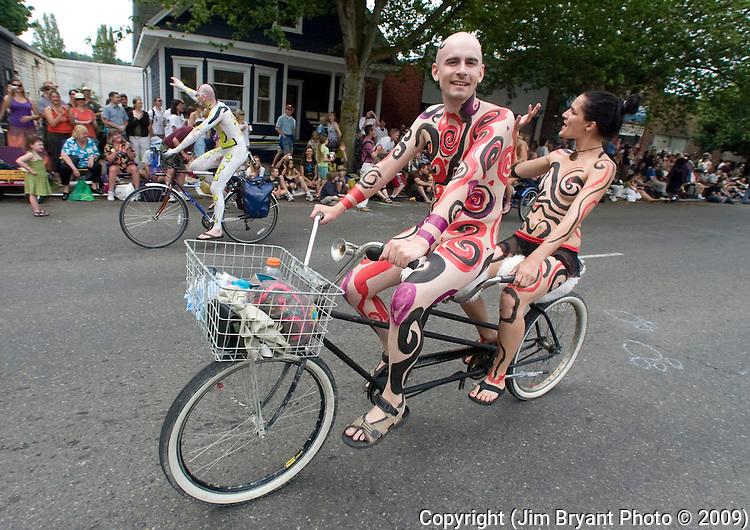 A pair of geometric painted bikers peddle down the street during the 21st Annual Fremont Summer Solstice Parade in Seattle on June 20, 2009.  The parade was held Saturday, bringing out painted and naked bicyclists, bands, belly dancers and floats. (Jim Bryant Photo © 2009)