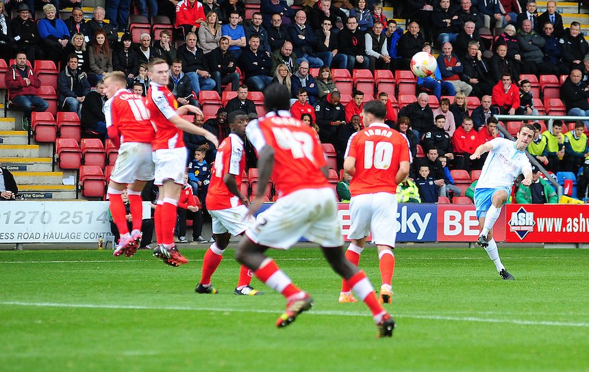 Coventry City's Danny Pugh strikes a free kick that ended up being deflected into the back of the net by Crewe Alexandra's Anthony Grant as Coventry City pull a goal back<br /> <br /> Photographer Chris Vaughan/CameraSport<br /> <br /> Football - The Football League Sky Bet League One - Crewe Alexandra v Coventry City - Saturday 11th October 2014 - Alexandra Stadium - Crewe<br /> <br /> &copy; CameraSport - 43 Linden Ave. Countesthorpe. Leicester. England. LE8 5PG - Tel: +44 (0) 116 277 4147 - admin@camerasport.com - www.camerasport.com