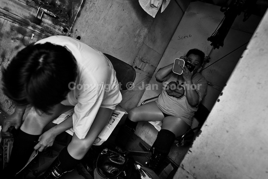 "A female Lucha libre wrestler La Fugitiva applies makeup in the backstage before a fight at a local arena in Mexico City, Mexico, 30 April 2011. Lucha libre, literally ""free fight"" in Spanish, is a unique Mexican sporting event and cultural phenomenon. Based on aerial acrobatics, rapid holds and the use of mysterious masks, Lucha libre features the wrestlers as fictional characters (Good vs. Evil). Women wrestlers, known as luchadoras, often wear bright shiny leotards, black pantyhose or other provocative costumes. Given the popularity of Lucha libre in Mexico, many wrestlers have reached the cult status, showing up in movies or TV shows. However, almost all female fighters are amateur part-time wrestlers or housewives. Passing through the dirty remote areas in the peripheries, listening to the obscene screams from the mainly male audience, these no-name luchadoras fight straight on the street and charge about 10 US dollars for a show. Still, most of the young luchadoras train hard and wrestle virtually anywhere dreaming to escape from the poverty and to become a star worshipped by the modern Mexican society."