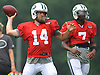 Ryan Fitzpatrick #14, New York Jets quarterback, throws a pass alongside #7 Geno Smith during training camp at Atlantic Health Jets Training Center in Florham Park, NJ on Saturday, July 30, 2016.