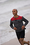 Man jogging on the beach