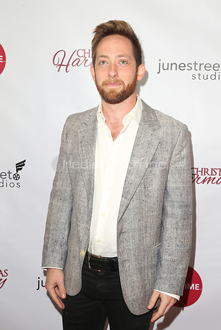 "LOS ANGELES, CA - NOVEMBER 7: Matthew Atticus Berger, at Premiere of Lifetime's ""Christmas Harmony"" at Harmony Gold Theatre in Los Angeles, California on November 7, 2018. Credit: Faye Sadou/MediaPunch"