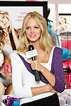 "Erin Heatherton being interviewed during the ""Incredible by Victoria's Secret"" launch at the Victoria Secret SOHO Store, August 10, 2010."