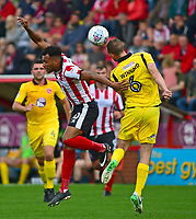 Lincoln City's Matt Green vies for possession with Morecambe's Dean Winnard<br /> <br /> Photographer Andrew Vaughan/CameraSport<br /> <br /> The EFL Sky Bet League Two - Lincoln City v Morecambe - Saturday August 12th 2017 - Sincil Bank - Lincoln<br /> <br /> World Copyright &copy; 2017 CameraSport. All rights reserved. 43 Linden Ave. Countesthorpe. Leicester. England. LE8 5PG - Tel: +44 (0) 116 277 4147 - admin@camerasport.com - www.camerasport.com