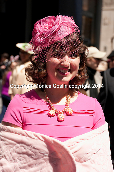 Woman wearing a pink dress, pink hat, and vintage necklace in the Easter Parade on Fifth Avenue in New York City