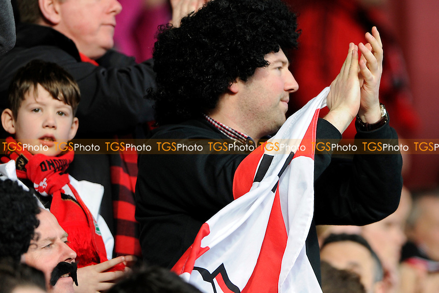 AFC Bournemouth fan - AFC Bournemouth vs Liverpool - FA Cup 4th Round Football at the Goldsands Stadium, Bournemouth, Dorset - 25/01/14 - MANDATORY CREDIT: Denis Murphy/TGSPHOTO - Self billing applies where appropriate - 0845 094 6026 - contact@tgsphoto.co.uk - NO UNPAID USE