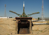Large gantry mechanisms on either side of the Soyuz TMA-205M spacecraft are raised into position to secure the rocket at the launch pad on Thursday, July 12, 2012 at the Baikonur Cosmodrome in Kazakhstan.  .Mandatory Credit: Carla Cioffi / NASA via CNP