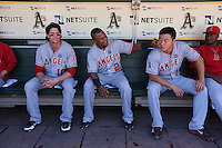 OAKLAND, CA - SEPTEMBER 18:  Grant Green #10, Erick Aybar #2, and Hank Conger #16 of the Los Angeles Angels get ready in the dugout before the game against the Oakland Athletics at O.co Coliseum on Wednesday, September 18, 2013 in Oakland, California. Photo by Brad Mangin