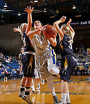 BROOKINGS, SD - OCTOBER 30:  Ellie Thompson #45 from South Dakota State University eyes the basket while splitting the defense of McKenzie Becker #10 and Kahlie Peterson #3 from South Dakota School of Mines in the second half of their exhibition game Thursday night at Frost Arena in Brookings. (Photo by Dave Eggen/Inertia)