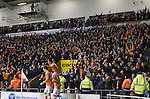 Home fans in the stands at Blackpool FC's Bloomfield Road stadium celebrating DJ Campbell's (number 39, being carried aloft by teammates) winning goal against Liverpool FC in a Premier League match. The home side won by two goals to one in front of a crowd of 16,089. It was the first time the clubs had met in a league match since Blackpool were last in the top division of English football in 1970-71.