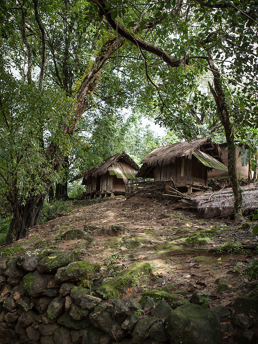 """The Wa traditional wooden house in the village of Wengding, Yunnan province, China. The Wa, which literally means """"mountain dwellers"""", is the hilltribe that inhabit the Sino-Burmese. Known as one of the last headhunting tribe until mid-twentieth century, their population in both countries now approximately no more than one million. In the homogenous society of modern China, Wa is one of more than 50 officially state-recognized ethnic minorities. They can be found around the southwestern corners of Yunnan province."""