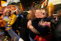 New York, NY - 1 January 1996 - Two women hug at the stroke of midnight in Times Square on New Year's Eve