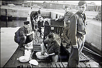 BNPS.co.uk (01202 558833)<br /> Pic: AlexanderHistoricalAuctions/BNPS<br /> <br /> Not all fun and games, crew members scrub the pots and pans.<br /> <br /> Fascinating images which provide a snapshot of life on a German U-Boat have been unearthed.<br /> <br /> Interestingly, the photographs give us an insight into joyous occasions on the U-976 destroyer including alcohol fuelled parties and gatherings in the mess hall.<br /> <br /> The photo album which was collated by First Officer Lieutenant Wilhelm Hinrichs has now emerged for auction and is tipped to sell for &pound;1,200.<br /> <br /> The U-976 was sunk on March 25, 1944, just a few months before the Normandy landings, near St Nazaire in France by gunfire from two British Mosquito fighter-bombers.