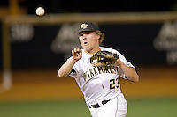 Wake Forest Demon Deacons second baseman Jimmy Redovian (23) makes a throw to first base against the Maryland Terrapins at Wake Forest Baseball Park on April 4, 2014 in Winston-Salem, North Carolina.  The Demon Deacons defeated the Terrapins 6-4.  (Brian Westerholt/Four Seam Images)