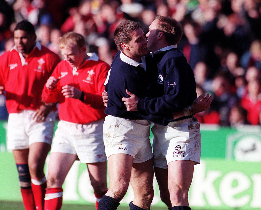Photo: Richard Lane.7.3.98 Wales v Scotland.Gregor Townsend celebrates his try with Alan Tait.