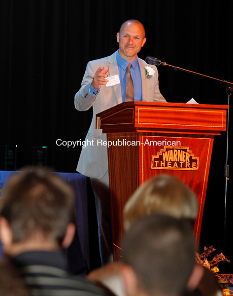 Torrington, CT-24 June 062414MK03 Brian E. Mattiello, whose name is associated with two of Torrington's largest institutions, Charlotte Hungerford Hospital and the Warner Theatre looks twards his children during his remarks after he was presented the Community Leader award by the Northwest Connecticut's Chamber of Commerce during the 2014 Celebration of Success in the Carole & Ray Neag Performing Arts Center at The Warner Theatre Tuesday evening.  The chamber also delivered two other distinguished leadership awards,  the Business Leadership award went to the Connecticut Mutual Holding Co. and The Quality of Life award was presented to the Northwestern Community College for its nursing and manufacturing programs.   Michael Kabelka / Republican-American