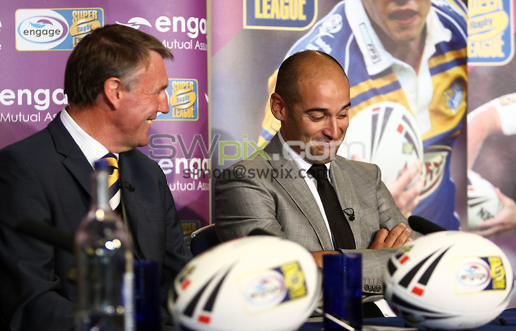 PICTURE BY VAUGHN RIDLEY/SWPIX.COM - Rugby League - Super League Playoffs - Leeds Rhinos 'Club Call' - Headingley, Leeds, England  - 27/09/09...Copyright - Simon Wilkinson - 07811267706...Catalans Dragons General Manager Christophe Levy (R) reacts to Leeds Rhinos Chief Executive Gary Hetherington (L) announcement that the Leeds Rhinos have chosen to play the Catalans Dragons in this weekends Semi-Finals.