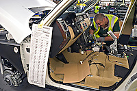 Manufacturing workers building Land Rover vehicle at Solihull plant Birmingham UK..©shoutpictures.com..john@shoutpictures.com