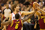 01/15/13--Portland Trail Blazers center Robin Lopez (42) reaches for a rebound against Cleveland Cavaliers shooting guard Matthew Dellavedova (8) in the first half at Moda Center.<br />