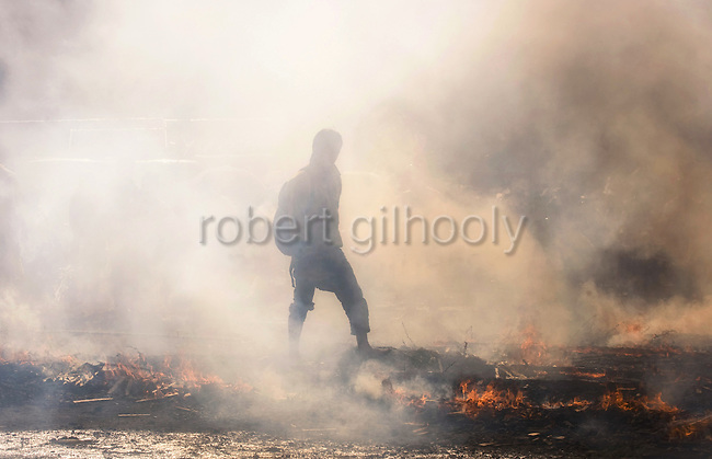 A man walks over the smoldering embers of a fire during a Buddhist purification ritual at Mt. Takao near Tokyo, Japan on March 14 2010.