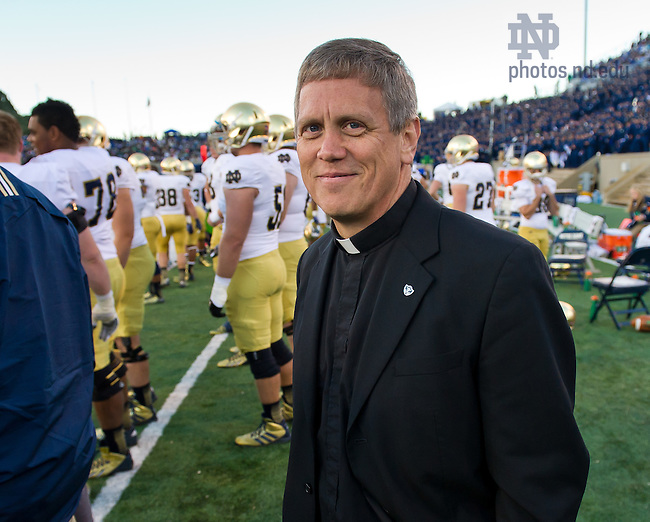 Oct 26, 2013; Fr. Mark Thesing, chaplain of the football team, on the sideline at the Air Force game, 2013.<br /> <br /> Photo by Matt Cashore