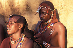 Maasai Moran platt each other's hair prior to an initiation ceremony that will take them into manhood. The Moran ( young warriors)  live in age sets being  brought up together they become like brothers.
