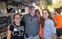 Ken Sulzer and his daughter Emily Sulzer '14 stand with friend Cristina Halstead at a food truck. Homecoming & Family Weekend, Friday and Saturday, Oct. 18-19, 2013. (Photo by Marc Campos, Occidental College Photographer)