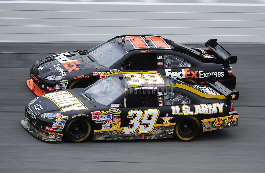 Feb 13, 2010; Daytona Beach, FL, USA; NASCAR Sprint Cup Series driver Ryan Newman (39) races alongside Denny Hamlin (11) during practice for the Daytona 500 at Daytona International Speedway. Mandatory Credit: Mark J. Rebilas-