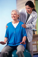 Physical therapist helps in rehabilitation of stroke patient.