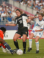 Goalkeeper Briana Scurry of the Atlanta Beat takes the ball off the foot of Rachel Hoffman of the New York Power as she fights off Atlanta's Amanda Cromwell. The Beat shut out the Power 2-0 on June 9th at Mitchel Athletic Complex.