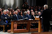 From left, President Donald Trump, first lady Melania Trump, former President Barack Obama, Michelle Obama, former President Bill Clinton, former Secretary of State Hillary Clinton, and former President Jimmy Carter listen as former Canadian Prime Minister Brian Mulroney speaks during a State Funeral at the National Cathedral, Wednesday, Dec. 5, 2018, in Washington, for former President George H.W. Bush. <br /> Credit: Alex Brandon / Pool via CNP