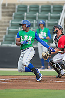 Elier Hernandez (12) of the Lexington Legends follows through on his swing against the Kannapolis Intimidators at CMC-Northeast Stadium on May 26, 2015 in Kannapolis, North Carolina.  The Intimidators defeated the Legends 4-1.  (Brian Westerholt/Four Seam Images)