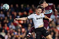 1st February 2020; Mestalla, Valencia, Spain; La Liga Football,Valencia versus Celta Vigo; Gabriel Fernandez of Celta heads a high ball challenged by Garbiel Paulista of Valencia CF
