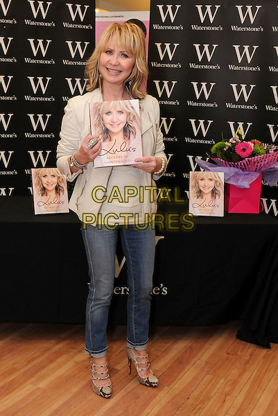 "LULU (Lulu Kennedy Cairns).Signs copies of her new book ""Lulu's Secrets To Looking Good"" at Waterstone's, Bluewater, Greenhithe, Kent, England, UK, 19th March 2010..full length jeans snake snakeskin beige print strappy shoes mary janes cream jacket top beads bracelets leather .CAP/BRC.©Ben Rector/Capital Pictures"