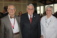 NWA Democrat-Gazette/CARIN SCHOPPMEYER Dr. Lee Parker, UAMS Northwest adjunct clinical professor (from left), and Lewis and Donna Epley visit at Friends of  UAMS.