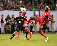 CHICAGO, IL - JULY 7: Gyasi Zardes #9 goes for the ball in front of Jonathan Dos Santos #6 during a game between Mexico and USMNT at Soldiers Field on July 7, 2019 in Chicago, Illinois.