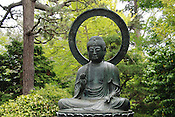A Buddha statue in the Japanese Garden area of Golden Gate State Park in San Francisco, California. Ernie Mastroianni photo