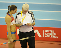 Photo: Ady Kerry/Richard Lane Photography..Aviva Grand Prix. 21/02/2009. .Yelena Isinbayeva talks with officials during the pole vault