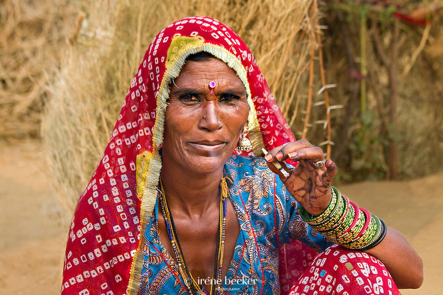 Smoking woman. Closeup of an woman smoking bidi, an Indian handmade cigarette made of tobacco or beedi leaves. Pushkar, Rajasthan, India.