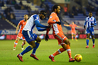Blackpool's Nathan Delfouneso vies for possession with Wigan Athletic's Cheyenne Dunkley<br /> <br /> Photographer Richard Martin-Roberts/CameraSport<br /> <br /> The EFL Sky Bet League One - Wigan Athletic v Blackpool - Tuesday 13th February 2018 - DW Stadium - Wigan<br /> <br /> World Copyright &copy; 2018 CameraSport. All rights reserved. 43 Linden Ave. Countesthorpe. Leicester. England. LE8 5PG - Tel: +44 (0) 116 277 4147 - admin@camerasport.com - www.camerasport.com