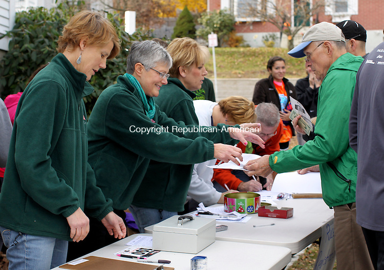 Thomaston, CT-14 November 2011-111311CM07-  (l-r) Susan Abbott, Cathy Fredlund and Robin Lampron, volunteers from Thomaston, check runners in before the start of the 9th annual Diane Burr Memorial Run in Thomaston Sunday afternoon.  The race raises money for families who are affected by cancer and also for the Thomaston Track Committee.   Christopher Massa Republican-American