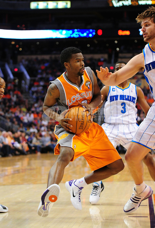 Mar. 25, 2011; Phoenix, AZ, USA; Phoenix Suns guard (0) Aaron Brooks against the New Orleans Hornets at the US Airways Center. The Hornets defeated the Suns 106-100. Mandatory Credit: Mark J. Rebilas-.