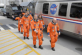 Kennedy Space Center, FL - August 8, 2007 -- The suited STS-118 crew moves quickly to the Astrovan after leaving the Operations and Checkout Building. From left are Mission Specialists Barbara R. Morgan, Rick Mastracchio and Dave Williams, Pilot Charlie Hobaugh, Mission Specialist Tracy Caldwell and Commander Scott Kelly. Behind Williams is Mission Specialist Alvin Drew. The Astrovan will take them to Launch Pad 39A for final suit preparations before climbing into Space Shuttle Endeavour for launch at 6:36 p.m EDT on Wednesday, August 8, 2007. The STS-118 mission is the 22nd shuttle flight to the International Space Station. It will continue space station construction by delivering a third starboard truss segment, S5, and other payloads such as the SPACEHAB module and the external stowage platform 3. The 11-day mission may be extended to as many as 14 depending on the test of the Station-to-Shuttle Power Transfer System that will allow the docked shuttle to draw electrical power from the station and extend its visits to the orbiting lab. .Credit: Kim Shiflett - NASA via CNP