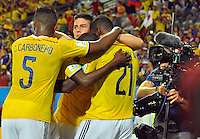 CUIABA - BRASIL -24-06-2014. James Rodriguez (#10), Carlos Carbonero (#5) y Jackson Martinez (#21) jugadores de Colombia (COL) celebra un gol anotado a Japón (JPN) durante partido del Grupo C de la Copa Mundial de la FIFA Brasil 2014 jugado en el estadio Arena Pantanal de Cuiaba./ James Rodriguez (#10), Carlos Carbonero (#5) and Jackson Martinez (#21) players of Colombia (COL) celebrate a goal scored to Japan (JPN) during the macth of the Group C of the 2014 FIFA World Cup Brazil played at Arena Pantanal stadium in Cuiaba. Photo: VizzorImage / Alfredo Gutiérrez / Contribuidor