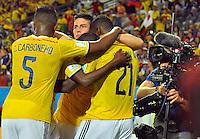 CUIABA - BRASIL -24-06-2014. James Rodriguez (#10), Carlos Carbonero (#5) y Jackson Martinez (#21) jugadores de Colombia (COL) celebra un gol anotado a Japón (JPN) durante partido del Grupo C de la Copa Mundial de la FIFA Brasil 2014 jugado en el estadio Arena Pantanal de Cuiaba./ James Rodriguez (#10), Carlos Carbonero (#5) and Jackson Martinez (#21) players of Colombia (COL) celebrate a goal scored to Japan (JPN) during the macth of the Group C of the 2014 FIFA World Cup Brazil played at Arena Pantanal stadium in Cuiaba. Photo: VizzorImage / Alfredo Gutiérrez / Contribuidor