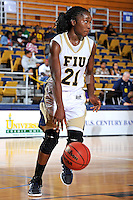 11 November 2011:  FIU's Timeyin Oritsesan (21) handles the ball in the second half as the FIU Golden Panthers defeated the Jacksonville University Dolphins, 63-37, at the U.S. Century Bank Arena in Miami, Florida.