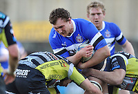 Nick Koster is tackled in possession. Amlin Challenge Cup match, between Bath Rugby and Calvisano on December 8, 2012 at the Recreation Ground in Bath, England. Photo by: Patrick Khachfe / Onside Images