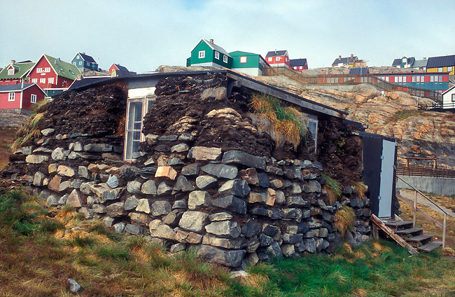 An old turf house in the town of Uummannaq. West Greenland.