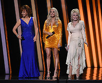 NASHVILLE, TN - NOVEMBER 13: Carrie Underwood, Reba McEntire, and Dolly Parton host the 53rd Annual CMA Awards at the Bridgestone Arena on November 13, 2019 in Nashville, Tennessee. (Photo by Frank Micelotta/PictureGroup)