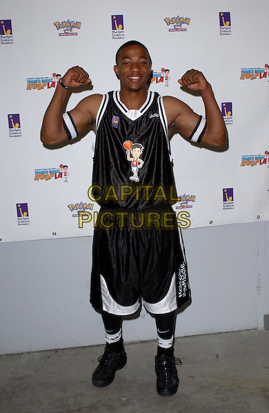 ARLEN ESCARPETA.2nd Annual Frankie Muniz HoopLA held at the Los Angeles Sports Arena in Los Angeles, California. Pokemon Trading Card Game hosts the celebrity basketball event to benefit Starlight Children's Foundation .14 March 2004.*UK Sales Only*.full length, full-length, funny, he-man posing.www.capitalpictures.com.sales@capitalpictures.com.©Capital Pictures.